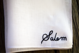 White linen handkerchief with embroidered name