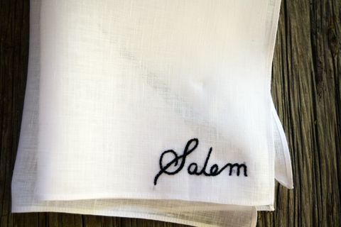 White Irish linen handkerchief with hand embroidered name, 'Salem'.