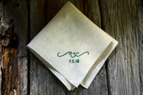 Oatmeal linen sweetheart handkerchief on wood boards