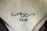 Close up of hand embroidered sweetheart handkerchief in emerald green.
