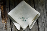 Oatmeal linen handkerchief hand embroidered with 'n + c, 7.5.18' in emerald green