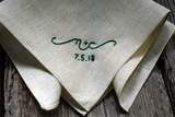 Soft beige handkerchief hand embroidered with green letters and date