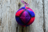 Japanese temari ball stitched in jewel tone triangles
