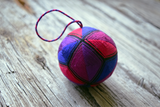 Kousa temari ball in stained glass colors outlined in black thread