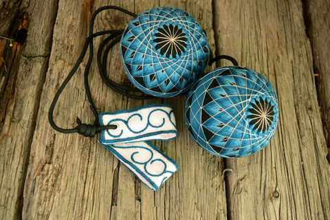 Hand embroidered temari poi in teal and silver on black bases