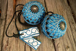 Hand embroidered temari poi in teal and black with swirl handles