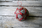 Hand embroidered japanese temari ball embroidered with pattern of interlocking stars