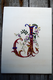 Ornate French gothic letter J worked in silk on cream dupioni, accented with gold metal threads