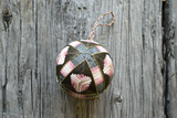 Temari ball in dusty rose and neutral shades hand embroidered and accented with gold