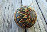 Tasseled Corn Japanese temari ball embroidered in harvest shades on wood background