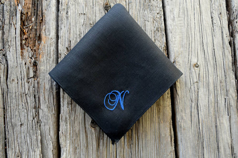 Black linen pocket square hand embroidered with letter N in blue