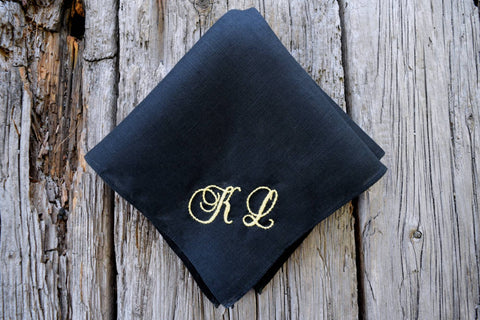 Black linen handkerchief hand embroidered with yellow KL in antique cursive script