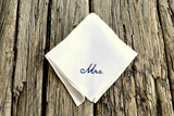 White Irish linen handkerchief hand embroidered with Mrs. in cursive script in black