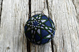 Japanese temari ball ornament embroidered in all over eight pointed stars in green and grey