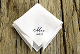 White linen hankie hand embroidered with Mrs and a wedding date in black