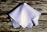 Irish linen handkerchief in white on wood background