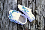 Infant bootees with blue forget me knots made from Irish linen
