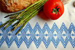 Hand embroidered white and blue tea towel with vegetables