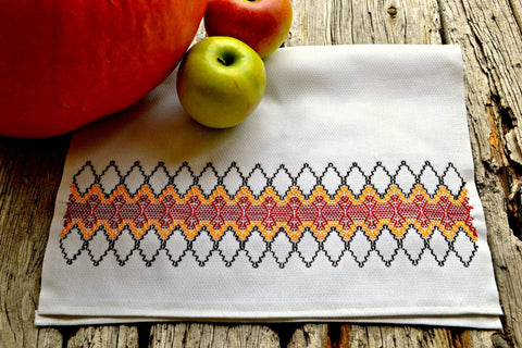 Hand embroidered huck kitchen towel with red and orange diamonds