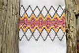 White huck kitchen towel with hand embroidered design in fall colors