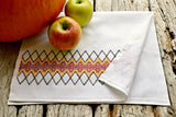 Huckaback tea towel stitched in harvest colors with apples