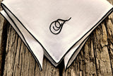 Closeup of hand embroidered pocket square showing stitching detail