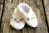 White linen baby booties hand embroidered with tiny ducks and cattails