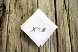White Irish linen handkerchief embroidered ' K (heart) B ' in black and green