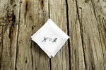 White wedding pocket square with sweetheart design on wood background