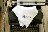 Irish linen handkerchief hand embroidered with Mrs. in black typewriter font on top of Royal typewriter