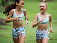 Impi Sportswear runners in running crops and shorts