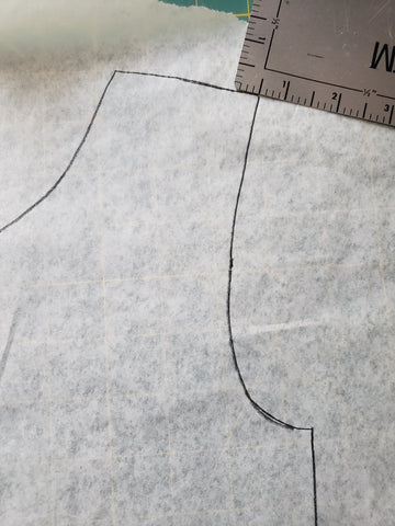"pattern piece with ruler measuring 1/2"" inside orginal armsyce"