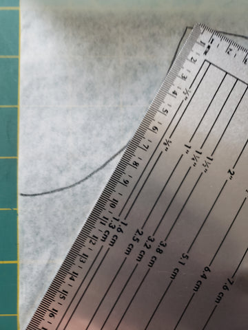 ruler at 30° angle to create v-neck