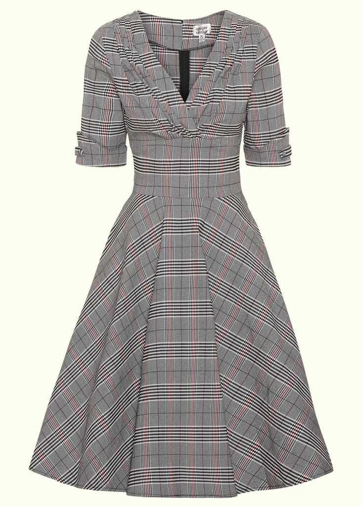 Unique Vintage: 1950s swing dress with V-neck in black and white tartan