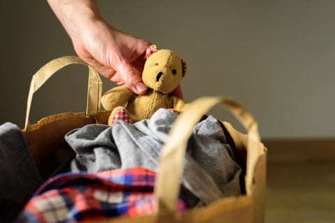 Clear clutter by donating unused clothes and toys like this teddy bear to charity.