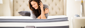 woman smiling on nice eurotop mattress