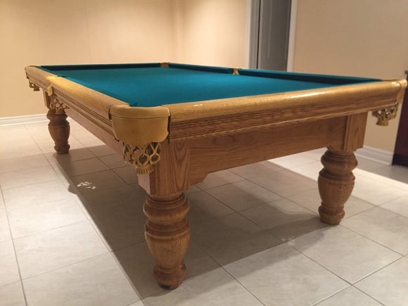 9' PREOWNED SOLID OAK SLATE POOL TABLE INSTALLED WITH ACCESSORIES