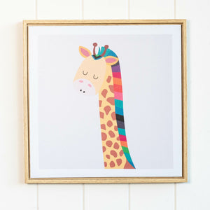 Framed Artwork Jnr – Rainbow Giraffe: Fill a nursery or play space with artwork that will grow with them such as this adorable canvas print. Featuring a lovable giraffe crafted in vivid colours with a natural coloured frame, this graceful giraffe will be a wonderful addition to any child-friendly space.