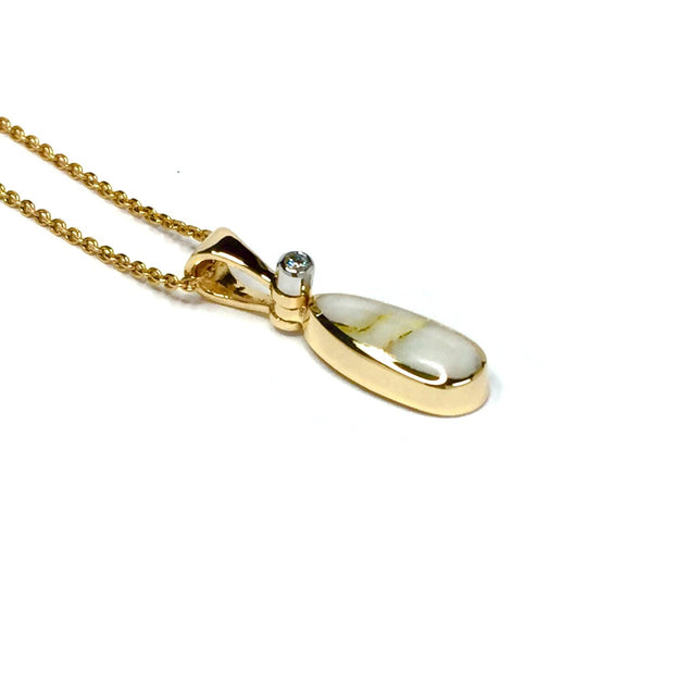 Gold quartz necklace pear shape inlaid pendant made of 14k yellow gold with a .02ct diamond