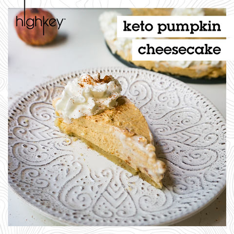 "Pumpkin Cheesecake slice on a white plate with text ""keto pumpkin cheesecake"""