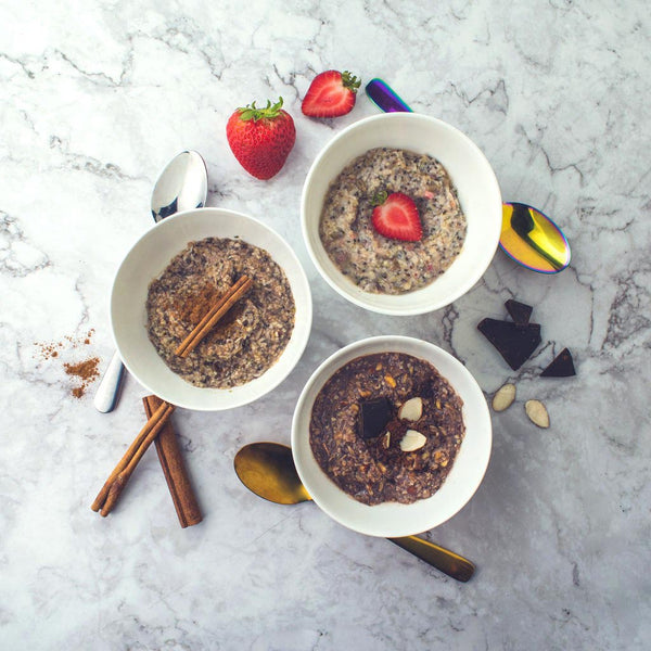 Bowls of each flavor of Instant Hot Cereal (Cinnamon, Strawberries + Cream, & Cocoa Almond