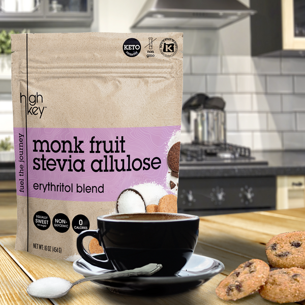 Bag of Monk Fruit Stevia Allulose - Erythritol Blend on counter top with coffee and Mini Chocolate Chip Cookies.