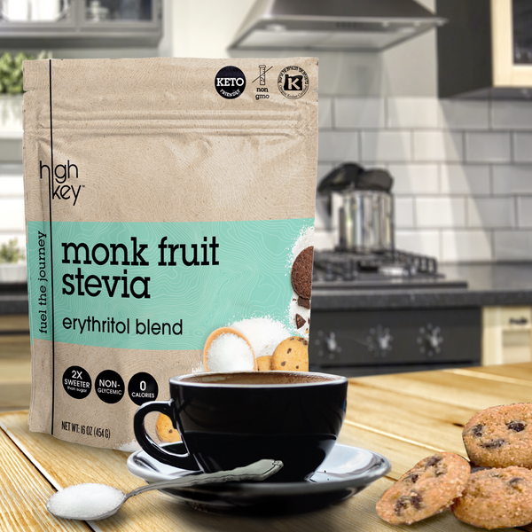 Bag of Monk Fruit Stevia on countertop with cup of coffee and Mini Chocolate Chip Cookies.
