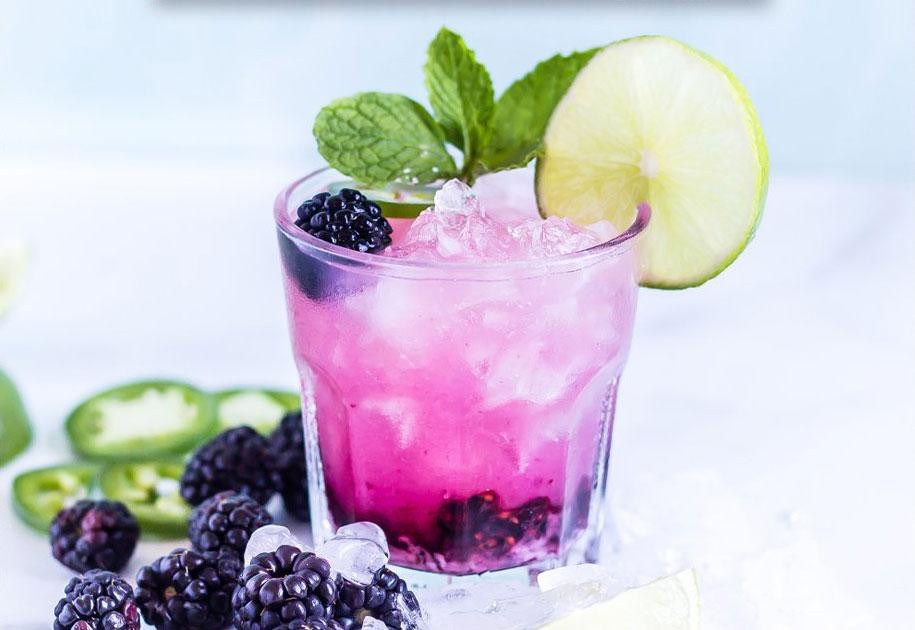 highkey keto friendly margarita with blackberries, jalapenos, and lime