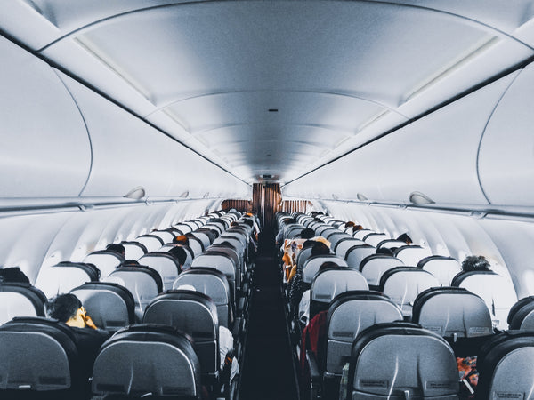 Inside of aircraft, looking down the aisle. Photo by Sourav Mishra from Pexels