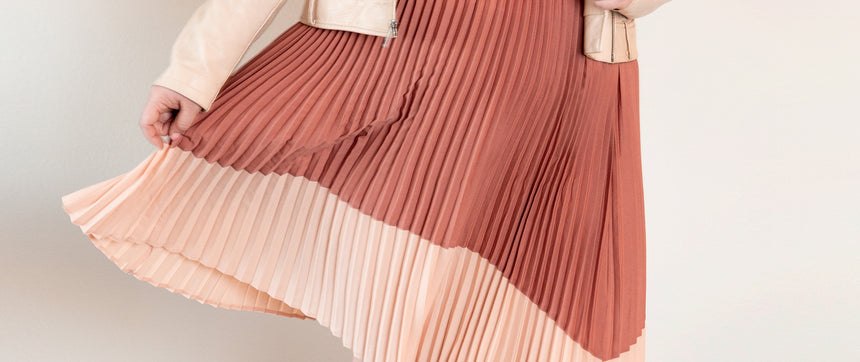 9 People Obsessed with the Pleated Midi Skirt