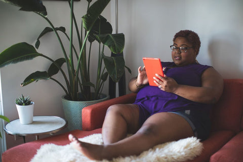 Plus-size woman on her tablet.