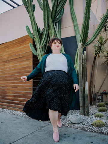 Model, Julia, wears the polka dot easy breezy skirt with the dreamy duster and a white tee.