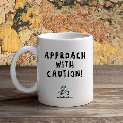 The Dead Thread™ Approach With Caution mug (male zombie)