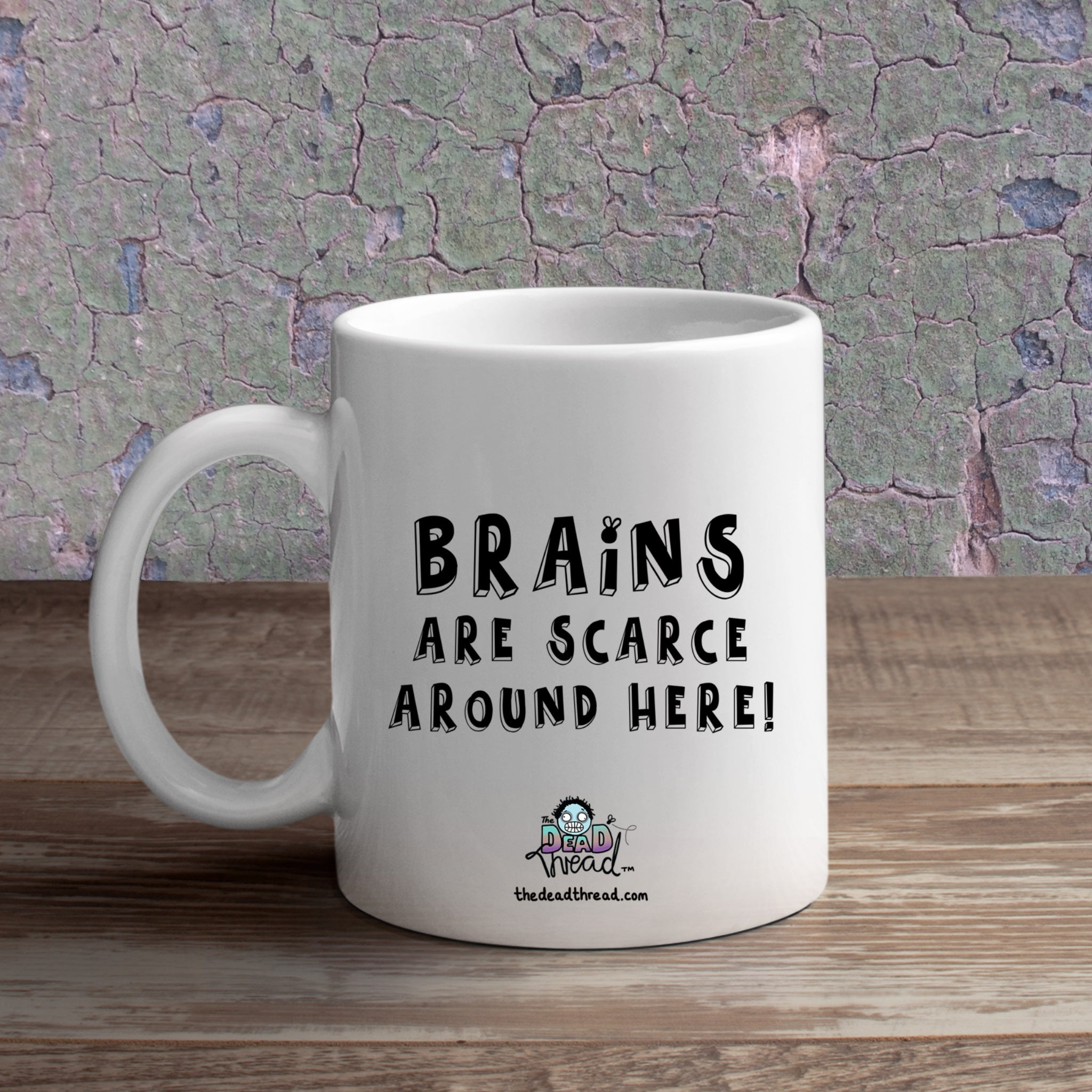 Brains Are A Bit Scarce Round Here (Female zombie) Mug from The Dead Thread™.
